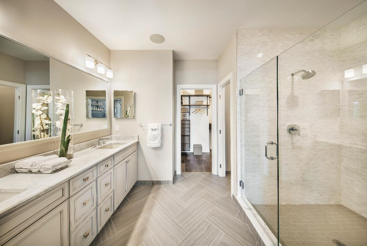 Primary bath with large shower and dual vanity