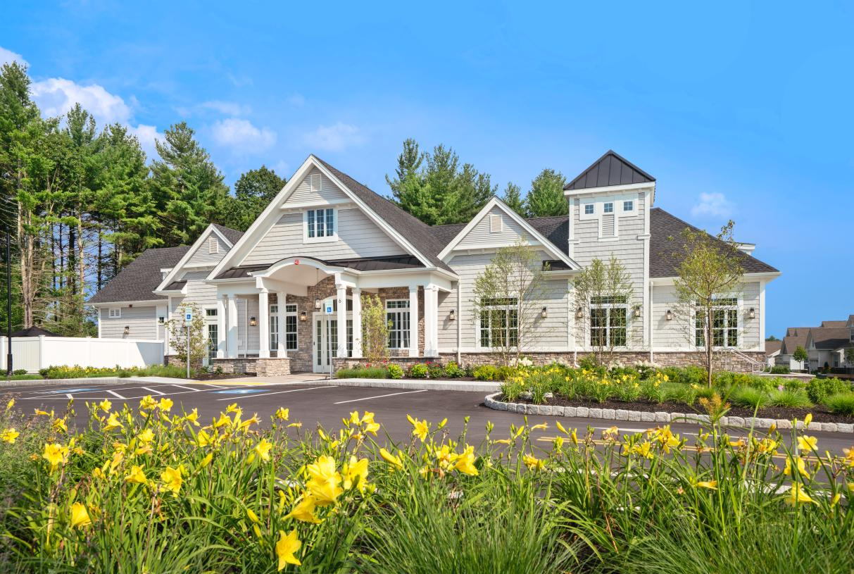 Beautiful landscaping surrounds the clubhouse