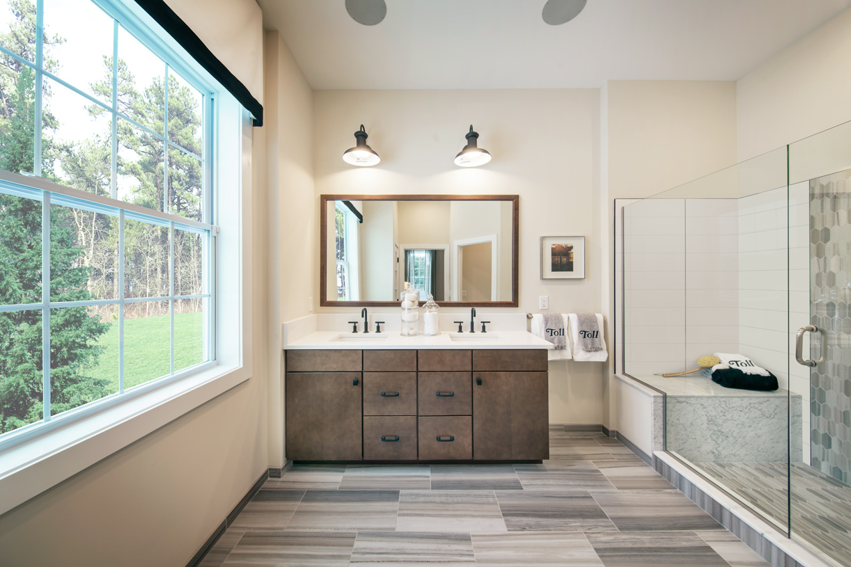 Primary bathroom with dual vanity and large shower