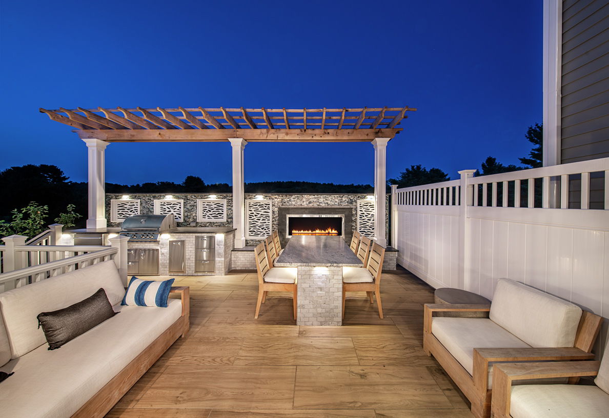 Outdoor living with built-in fireplace and grill
