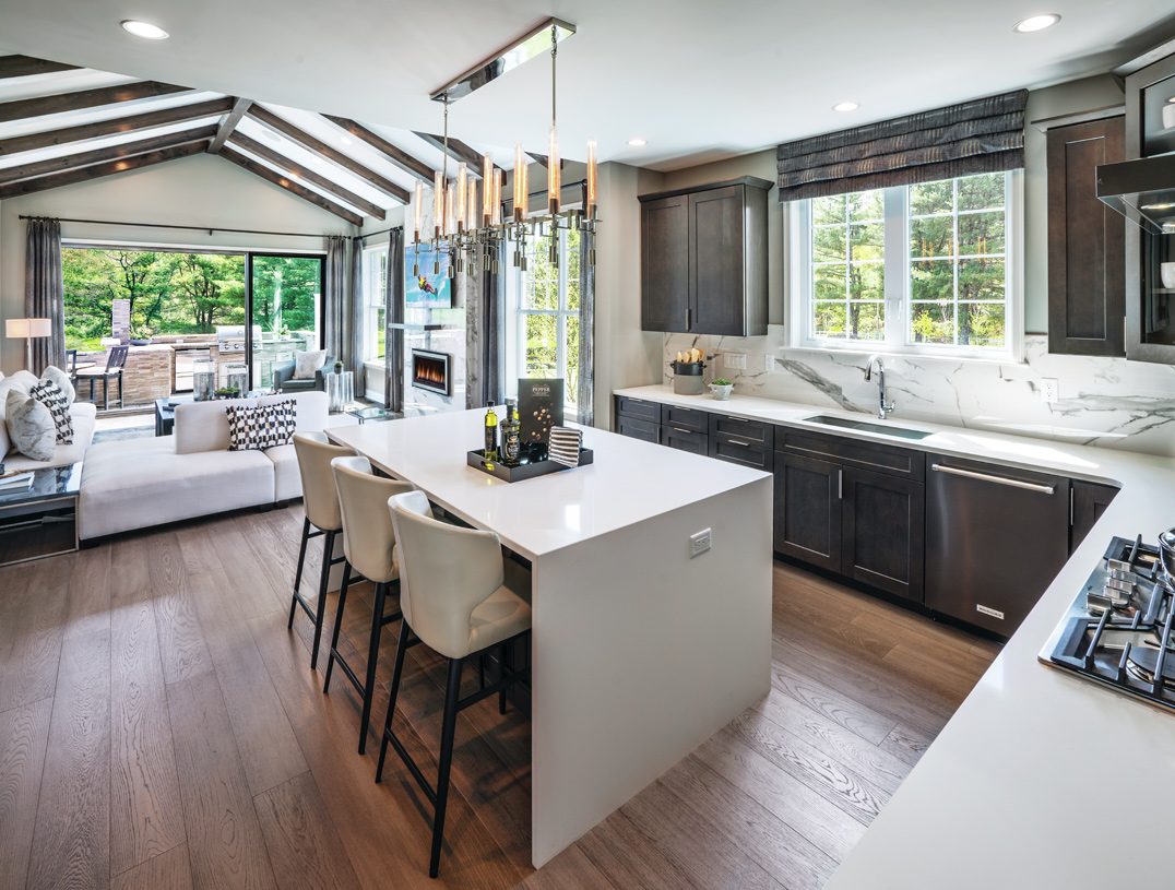 Kitchen open to great room with slider to outdoor living
