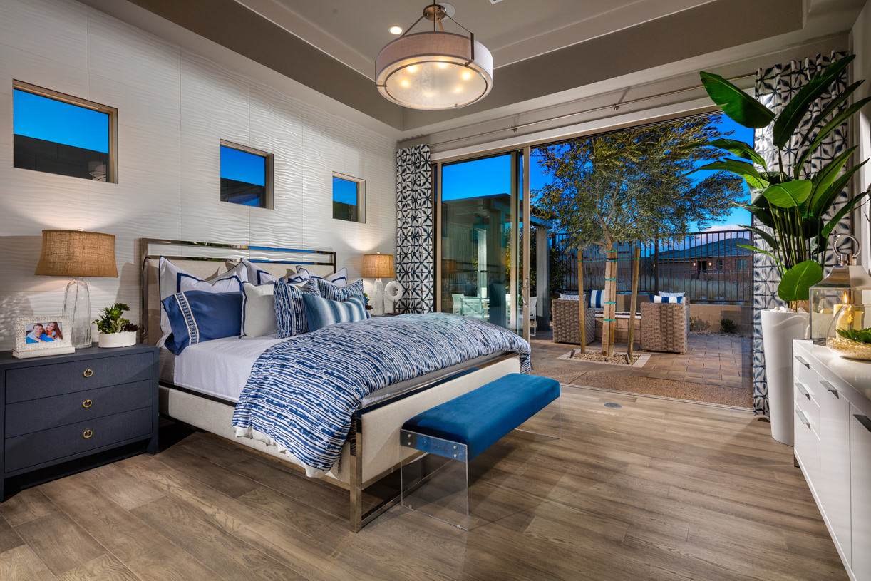 Spacious primary bedroom suites with walk-in closets and plenty of natural light
