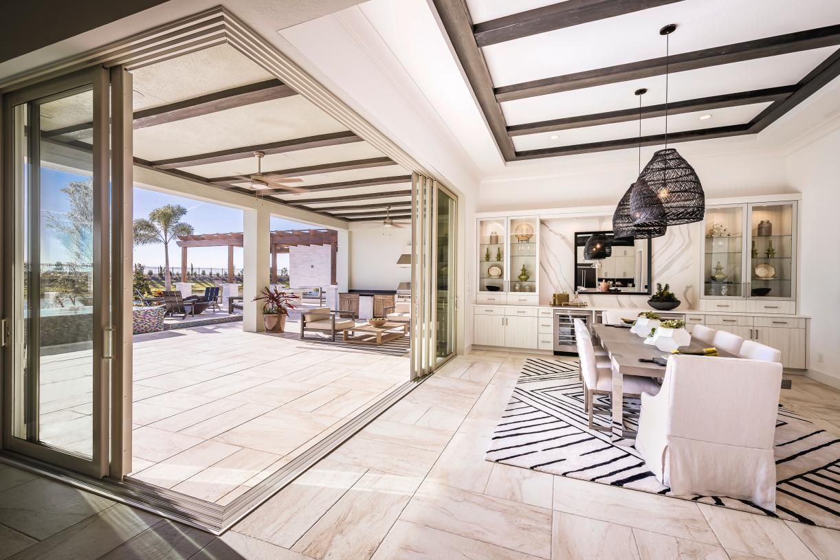 Expansive sliding glass doors lead to covered lanai