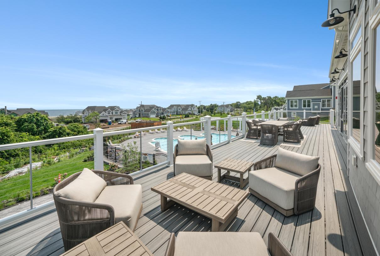 Outdoor clubhouse seating overlooking the outdoor pool