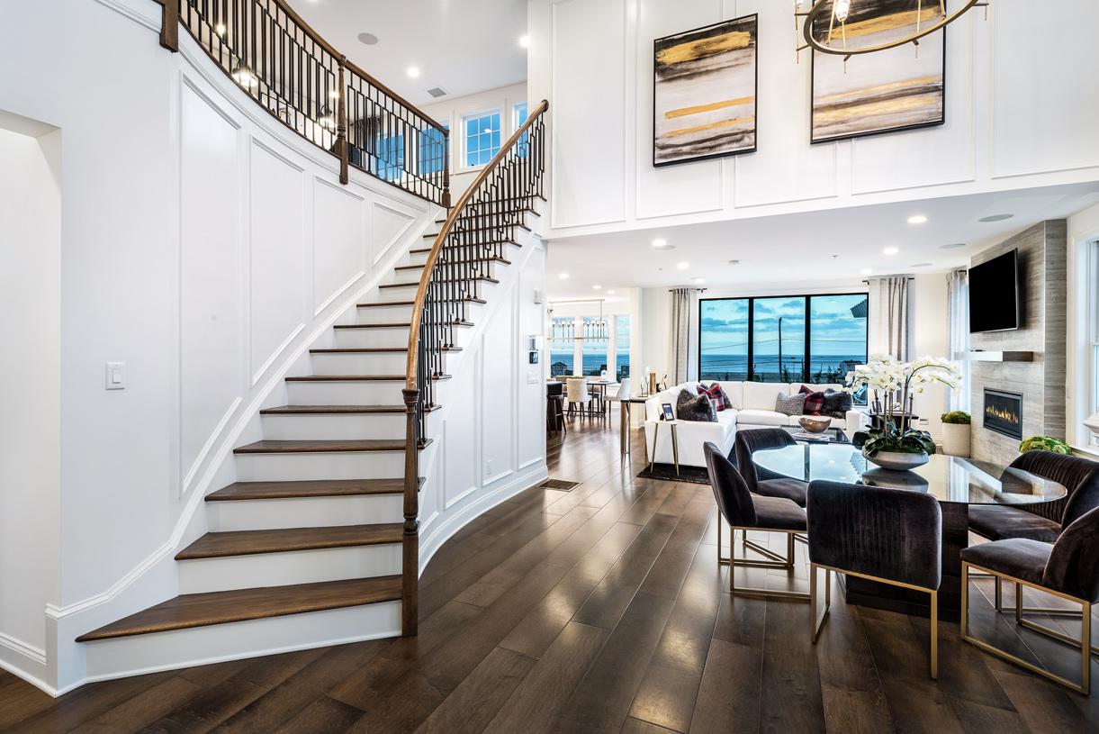 Two-story foyer leads up to an impressive loft space and secondary bedroom