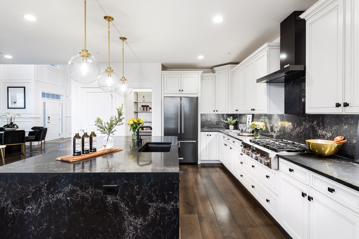 Elegantly designed kitchen with a center island showcasing a waterfall countertop