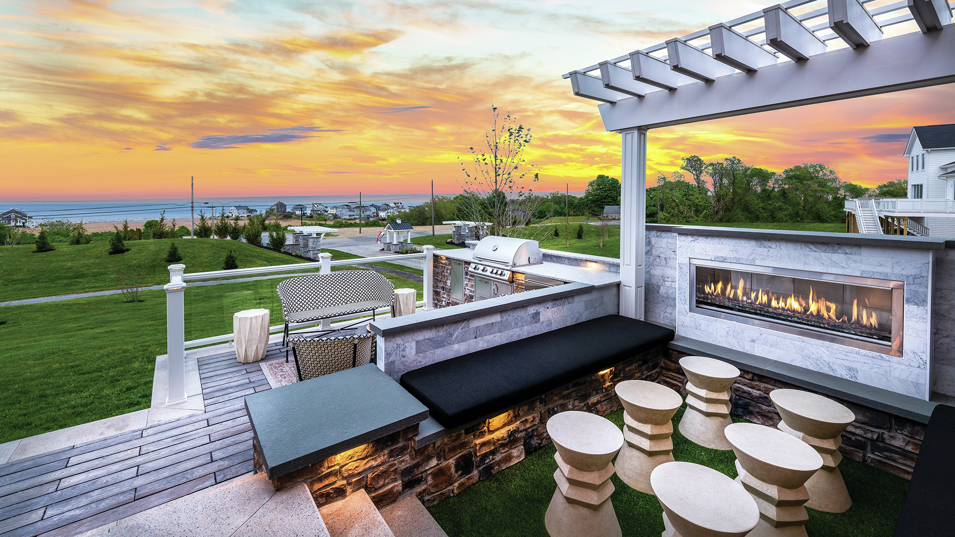 Take in the sunset by the fire in this outdoor living area