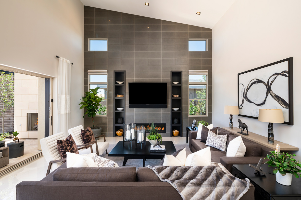 Open concept great room with stunning featured wall