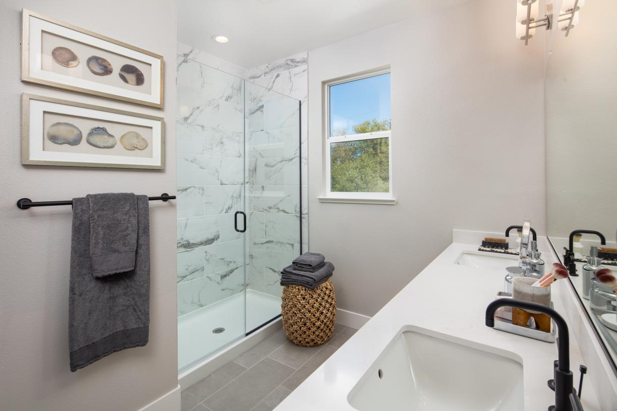 Primary bathroom with dual vanity and walk-in shower
