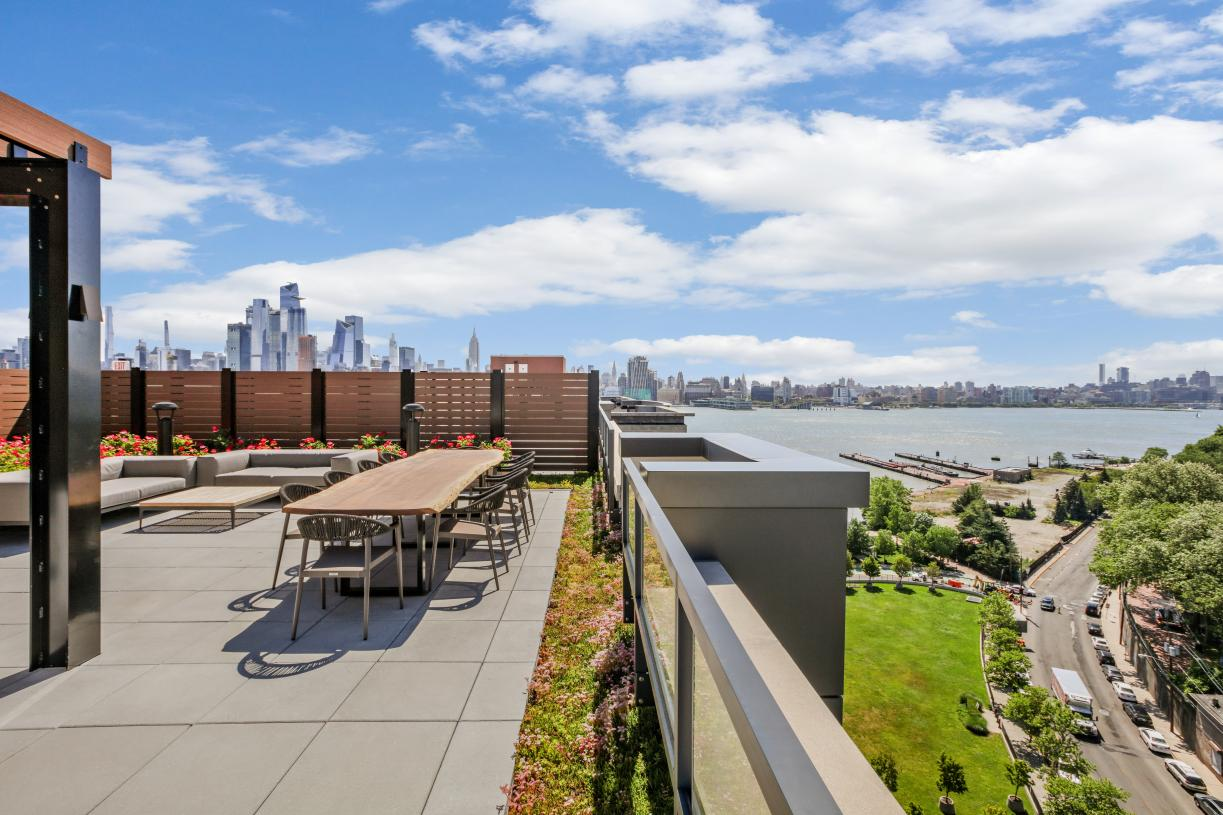 Rooftop terrace with grilling and dining areas