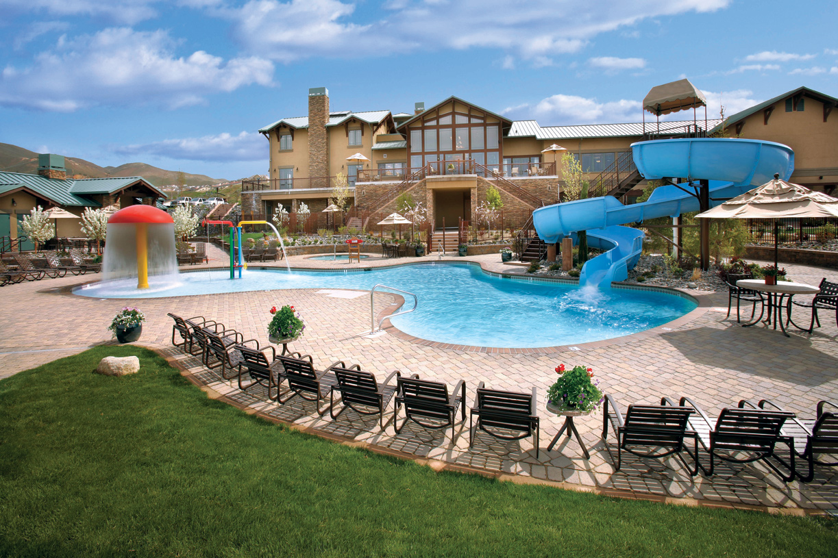 Enjoy access to resort-style amenities including two outdoor swimming pools and a 98-foot water slide