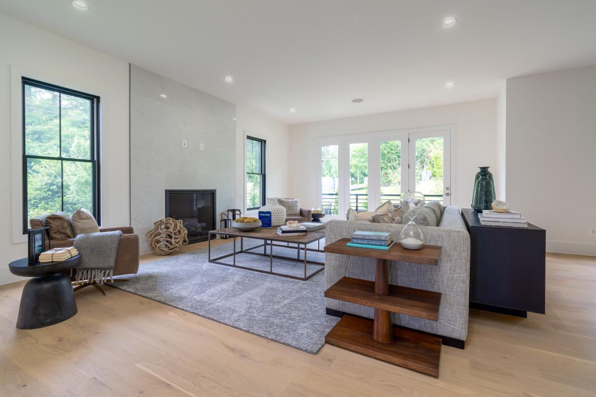 Expansive family room with 10-foot ceilings abundance of light, designer fireplace and easy access to rear yard and outdoor kitchen area