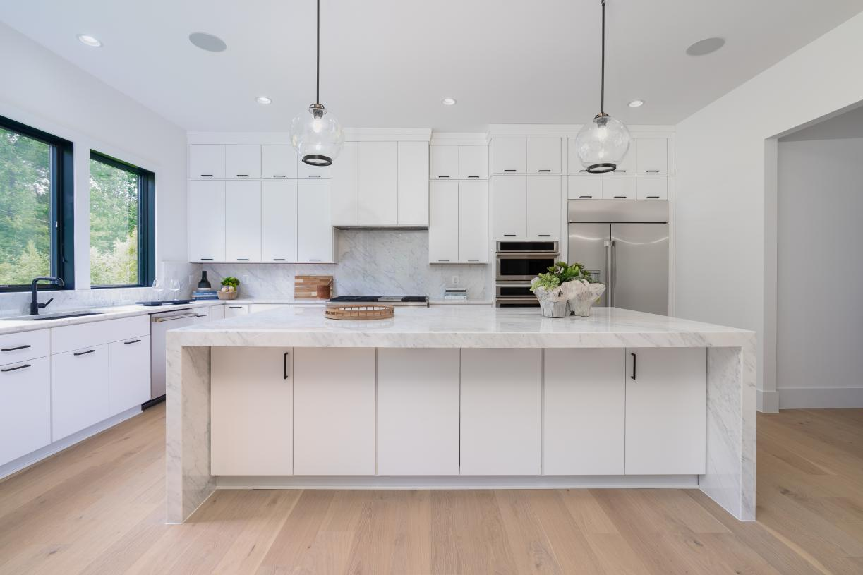 gourmet kitchen with expansive center island and upgraded appliances