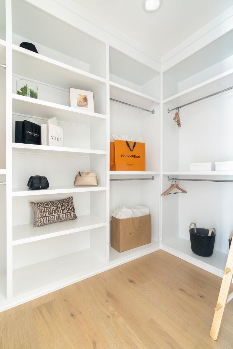 Dual primary closets with personalized built-in shelving