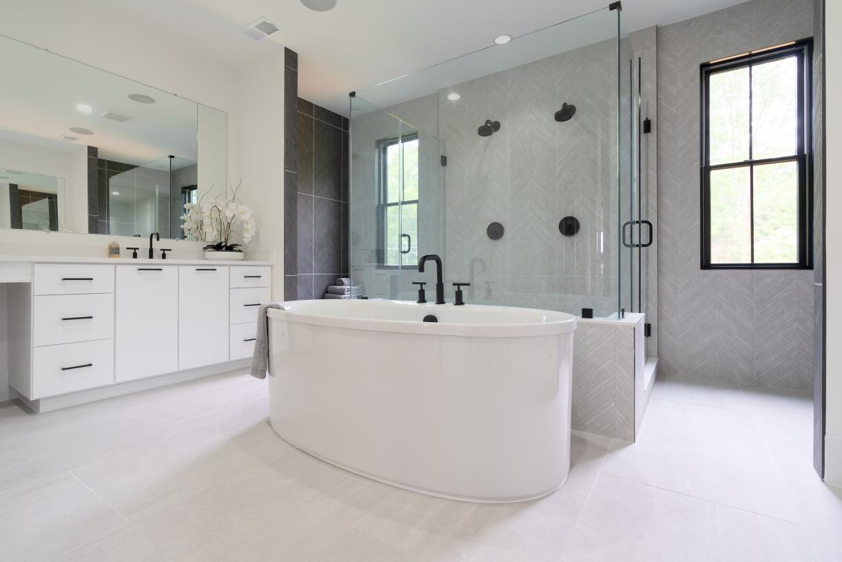 Primary luxury bath with free-standing tub, dual shower-heads and rain shower