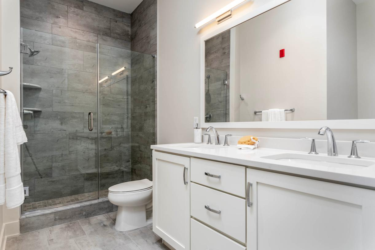 Representative photo: Spa-like primary bath with dual sink vanity