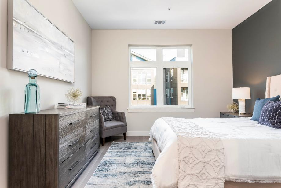 Representative photo: Light-filled primary bedroom with walk-in closet