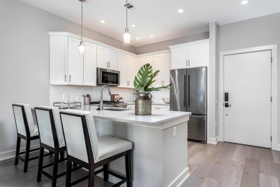 Representative photo: Stylish kitchen features name-brand appliances and Quartz countertops