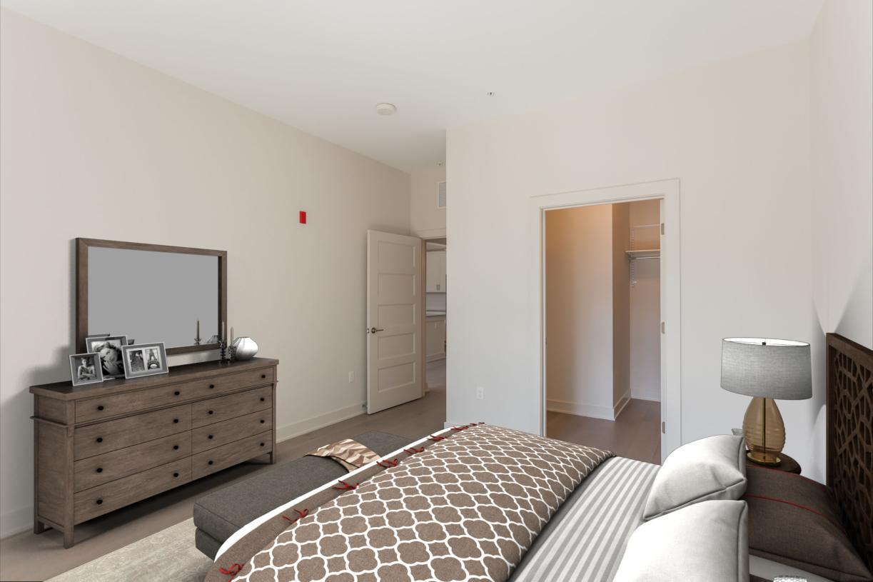Representative photo: Light and airy primary bedroom with walk-in closet