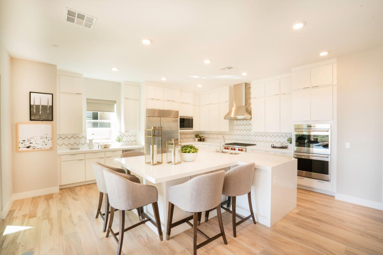 Gourmet kitchen with lowered breakfast bar extension