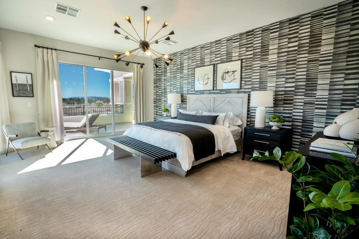 Luxury primary bedroom suite with deck access