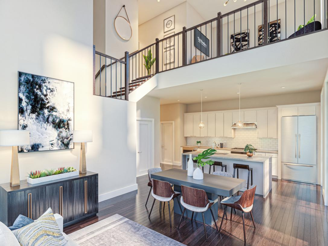 Open-concept living into kitchen, dining and living room