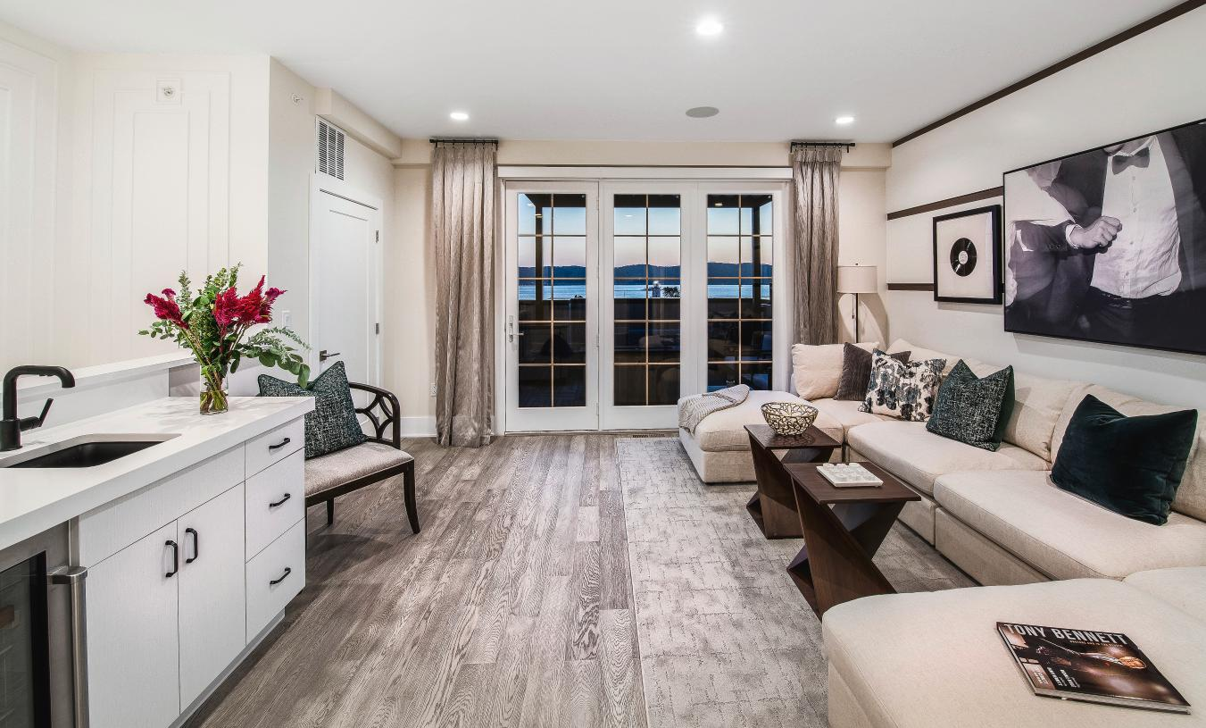 Fourth floor provides living space and full wet bar leading outside to outdoor living