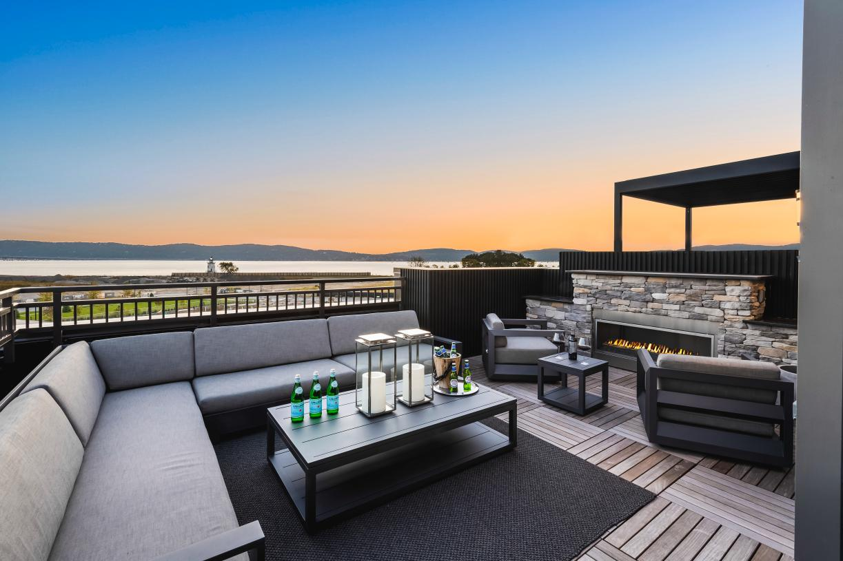 Enjoy your private rooftop retreat as the sun sets