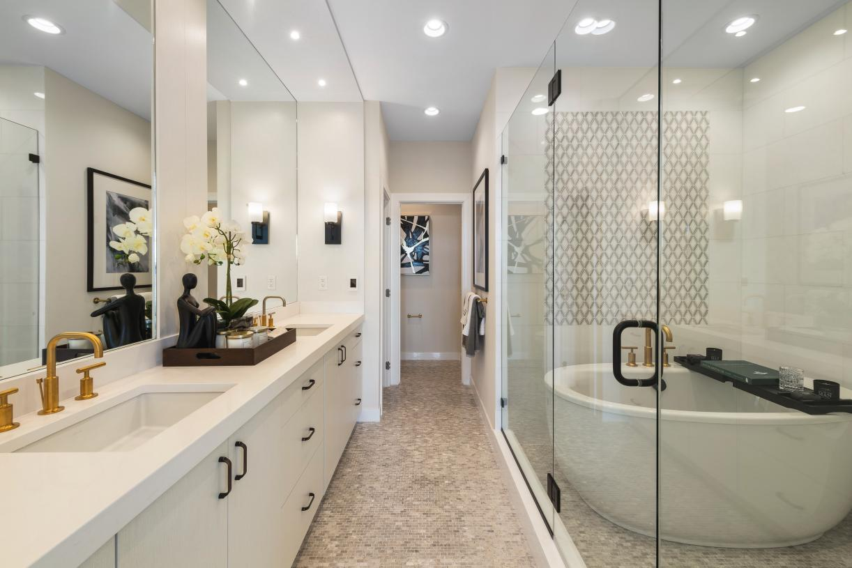 Stunning primary bathroom features dual-vanity sinks and freestanding tub