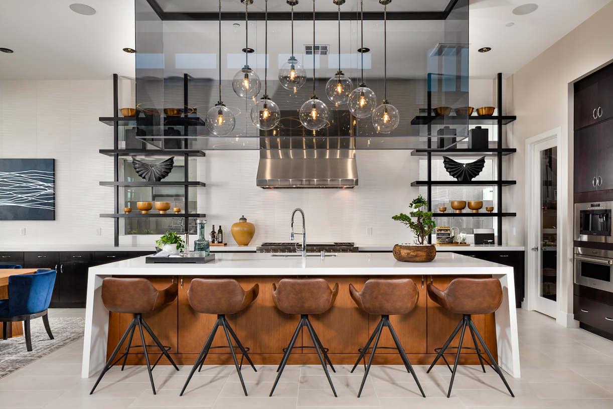 Well-equipped kitchen with large center island and breakfast bar