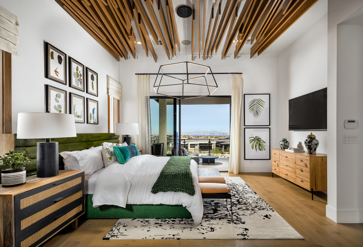 Palatial primary bedroom with private covered deck