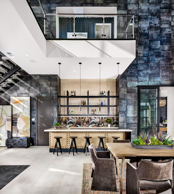 Two-story great room showcases an impressive wet bar