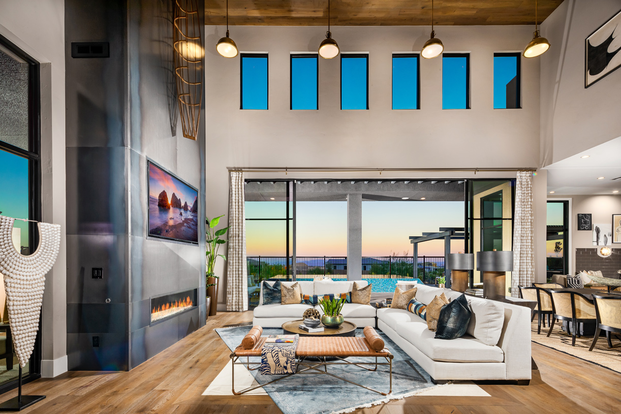 Great room with fireplace opens to outdoor living