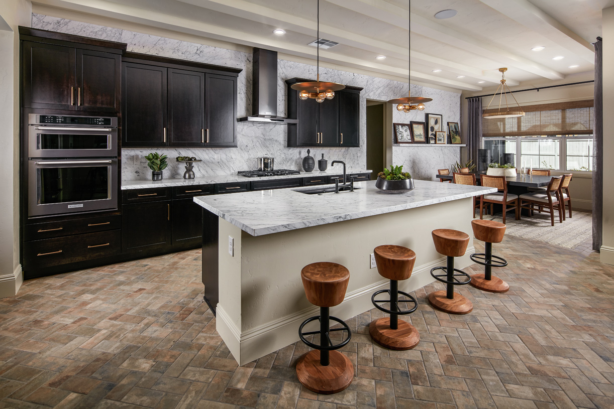 Gourmet kitchen in the Durham home design with large island