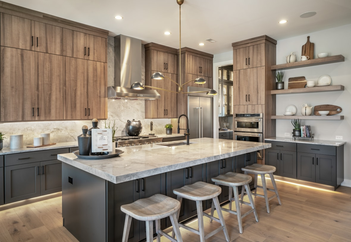 Two-toned cabinets Create a dramatic look and provide ample storage space