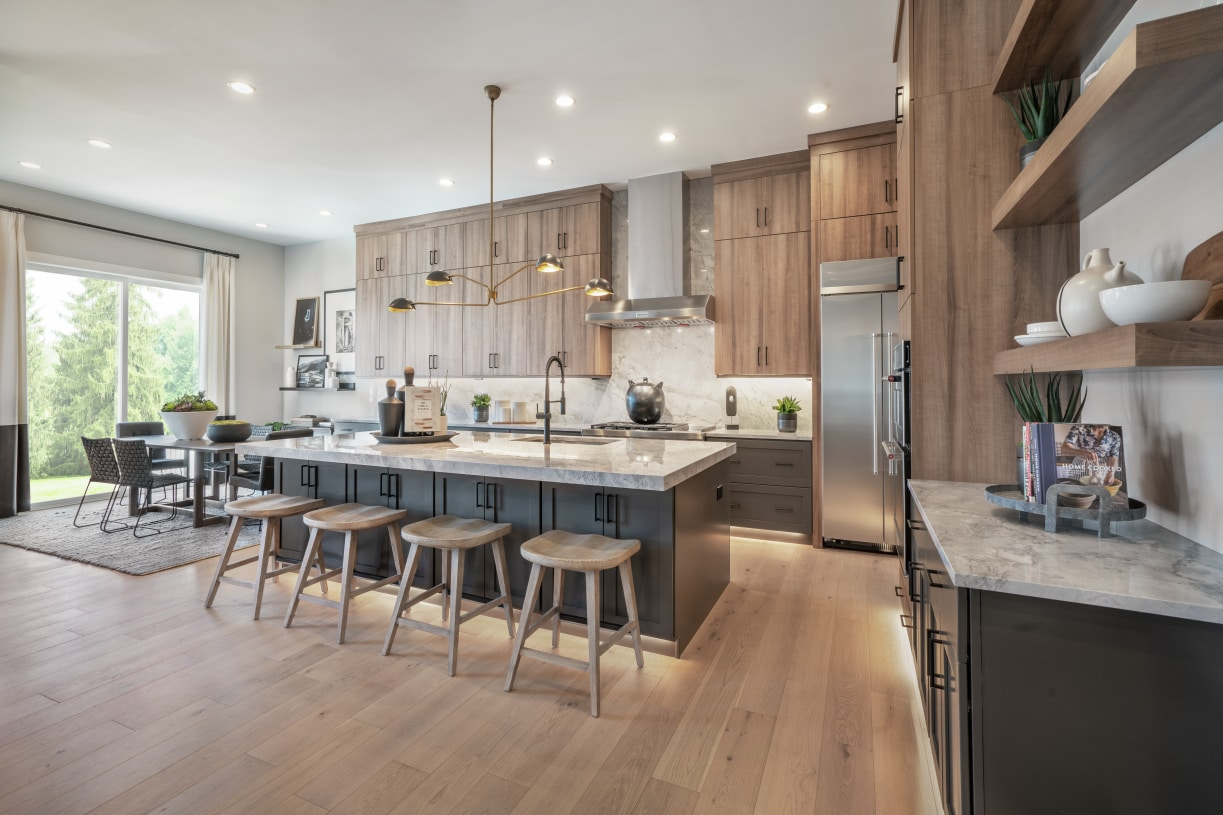 Well-designed kitchen with center island overlooking great room