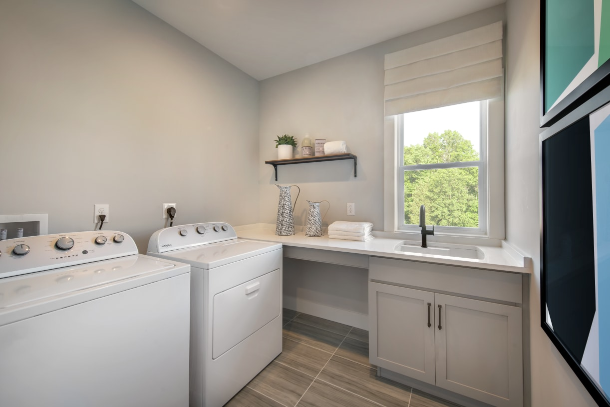 Laundry room conveniently located on second floor