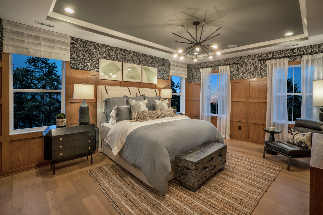 Spacious primary bedroom suite with private bath and walk-in closets