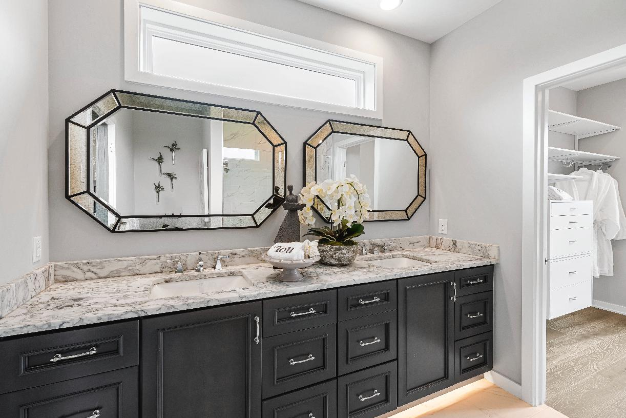 Spa-like primary bathroom with dual-sink vanity