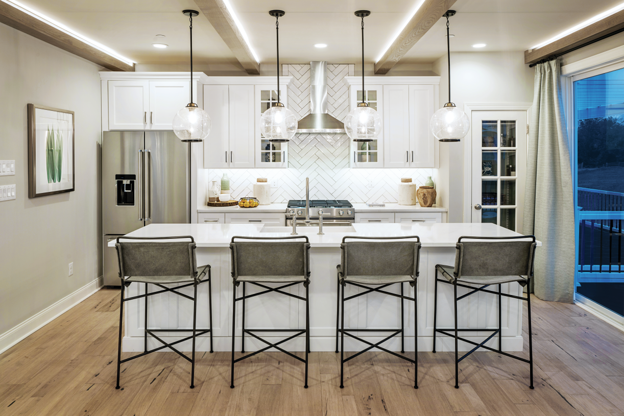 Kitchen features a large island with breakfast bar