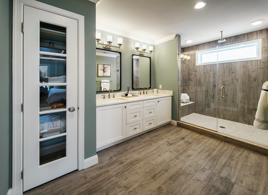 Primary bathroom features a linen closet