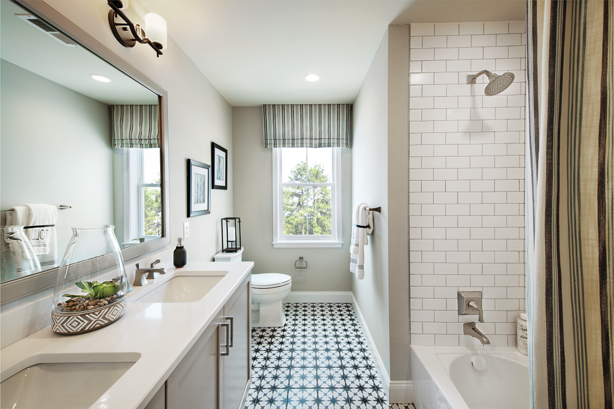 Shared full hall bath with dual-sink vanity