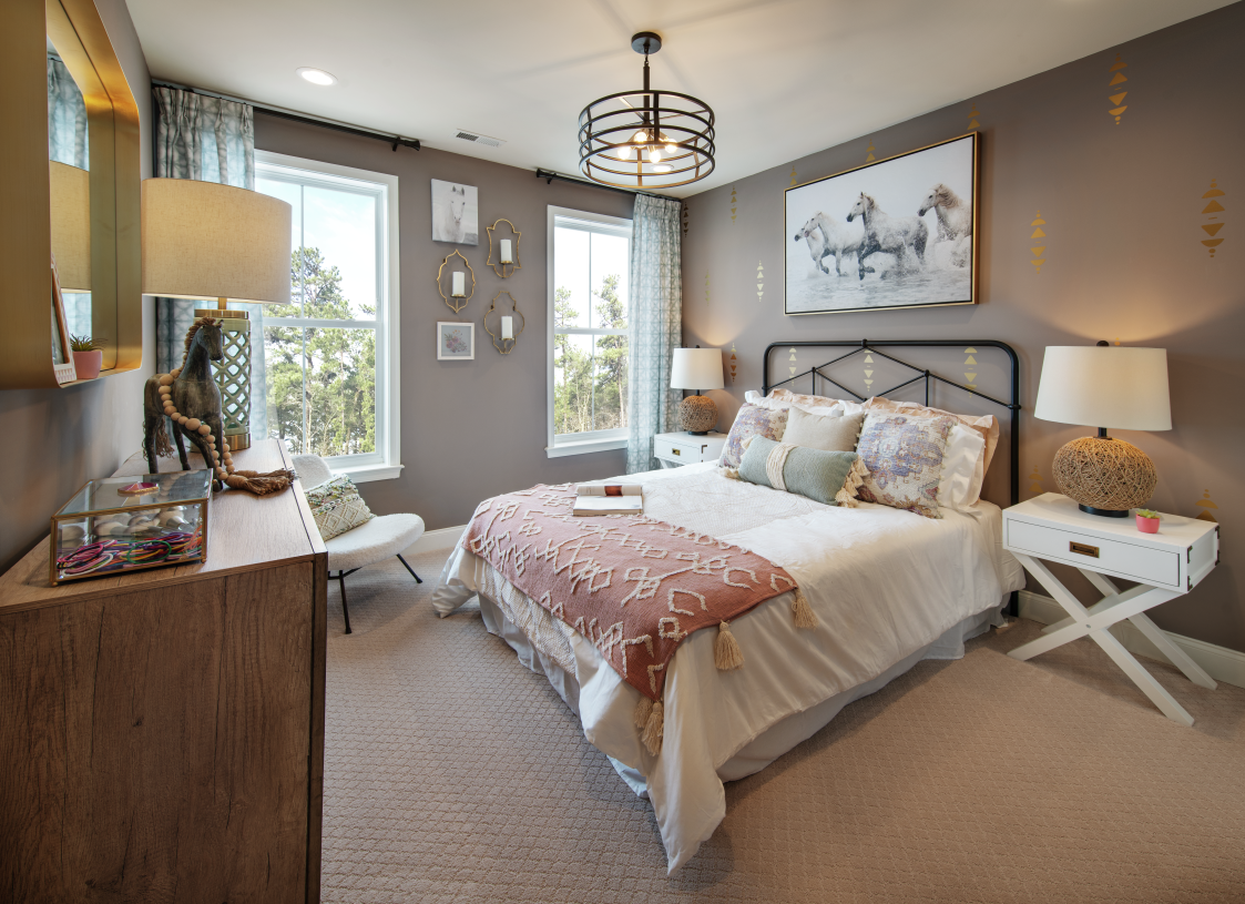Secondary bedrooms are located on the second floor