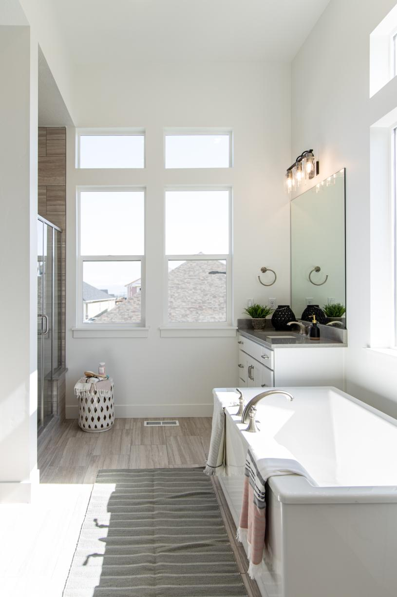 Lavish primary bathroom ideal for relaxation