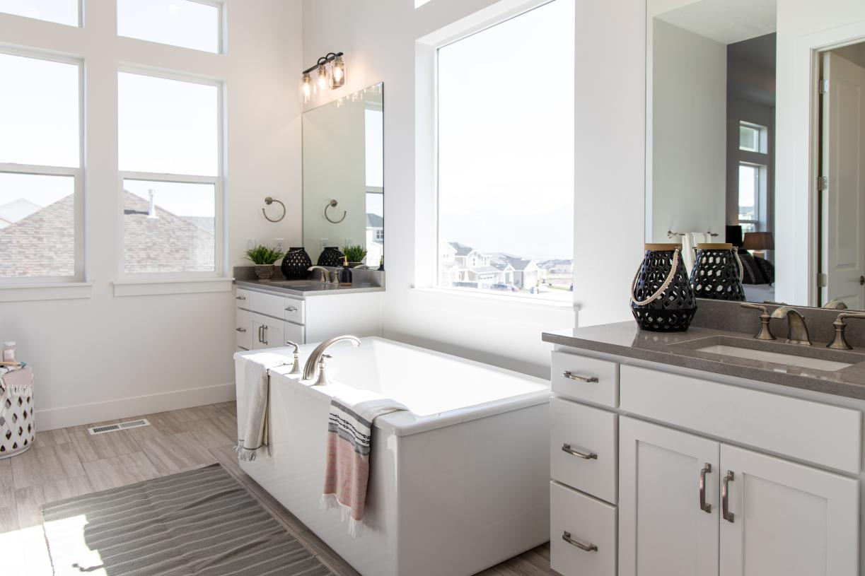 Beautiful primary bathrooms with dual vanities, large soaking tub, and walk-in shower