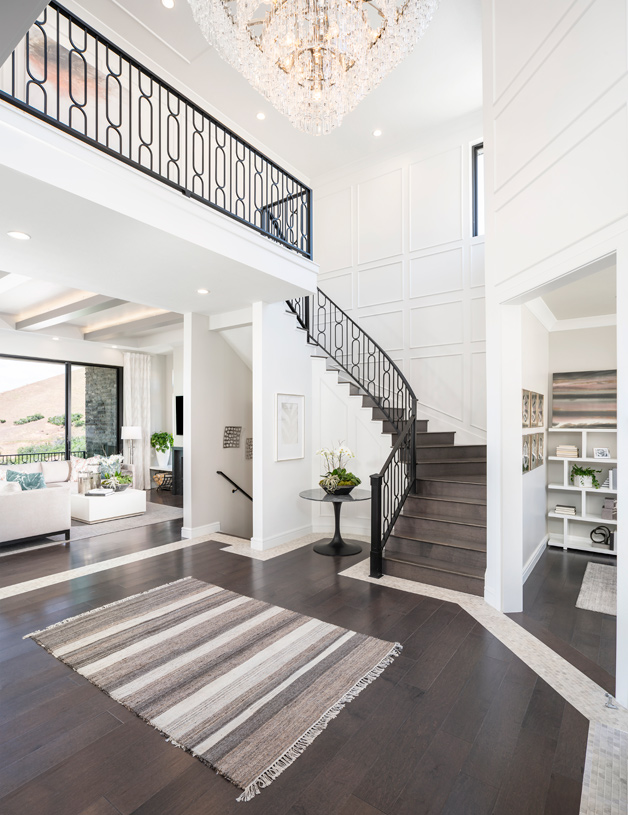 Impeccable Friberg entrance with beautiful wraparound staircase