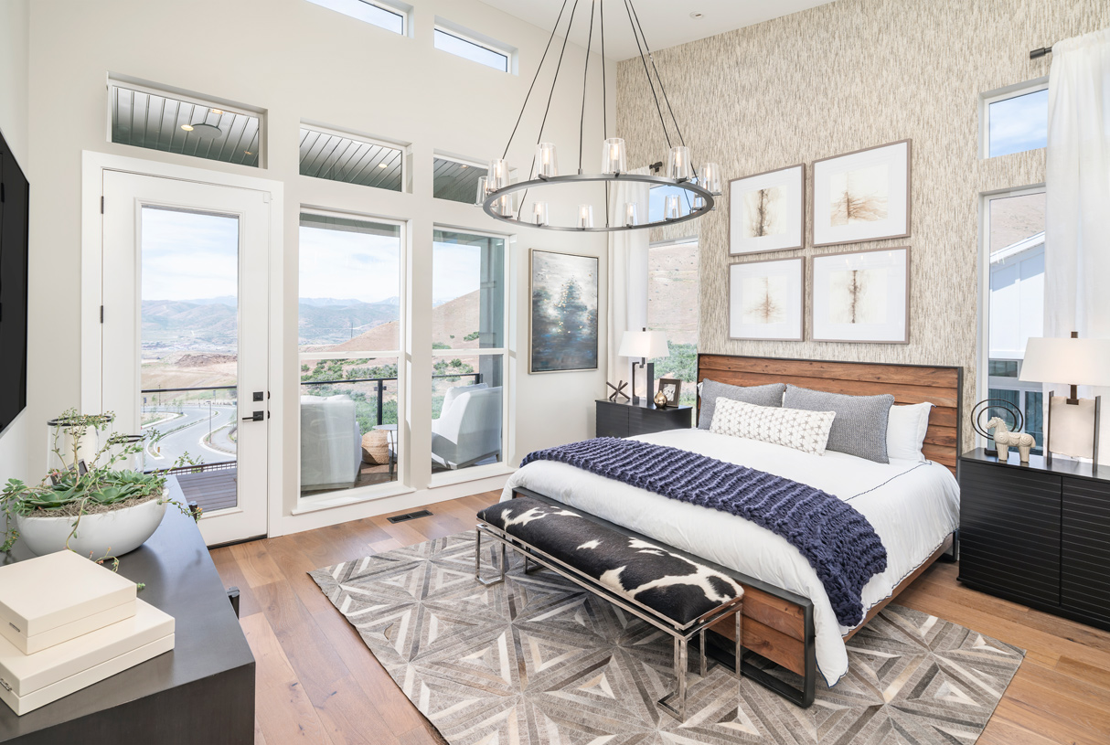 Spacious primary bedroom with walkout luxury outdoor living