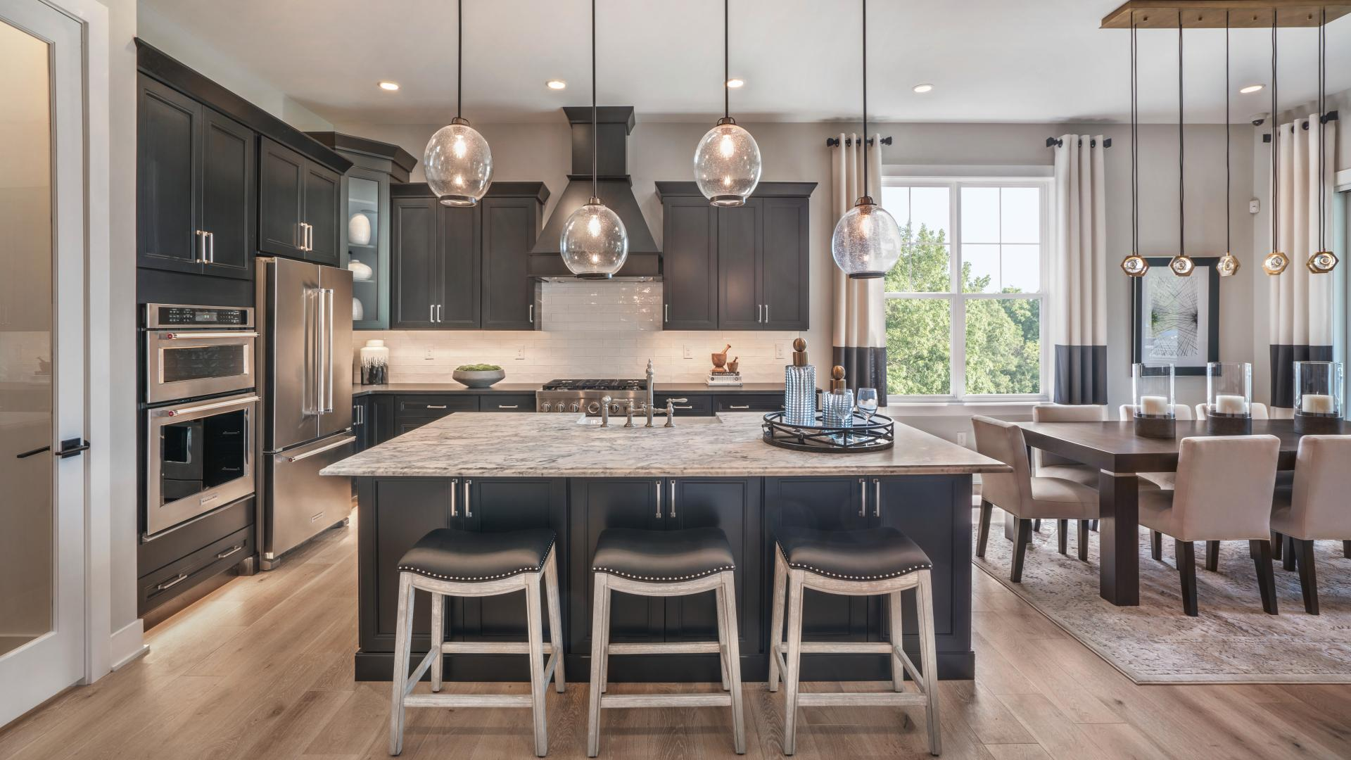 Odessa home design features a well-designed kitchen with large center island