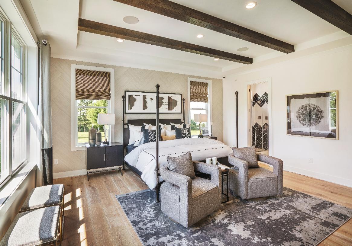 Serene first-floor primary bedroom suite
