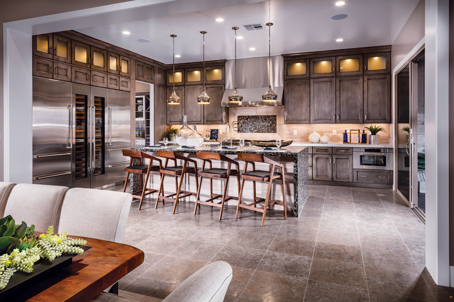 Open-concept gourmet kitchens have well-designed islands